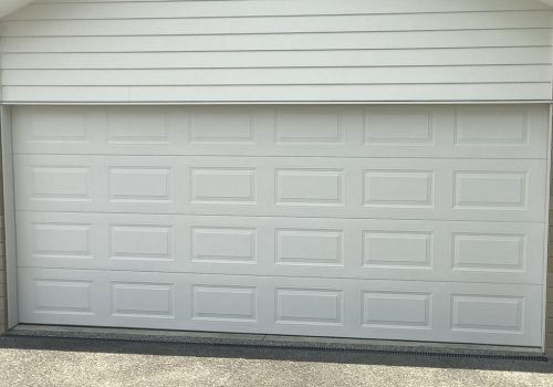hibiscus-garage-doors-pressed-panel-1