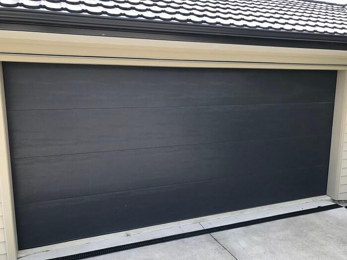 hibiscus-garage-doors-flat-woodgrain-1
