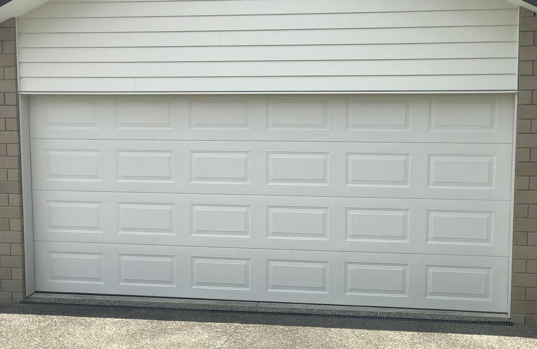 hibiscus-garage-doors-pressed-panel-1