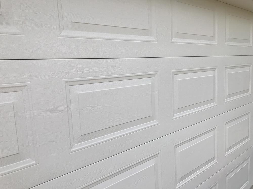 hibiscus-garage-doors-pressed-panel-2